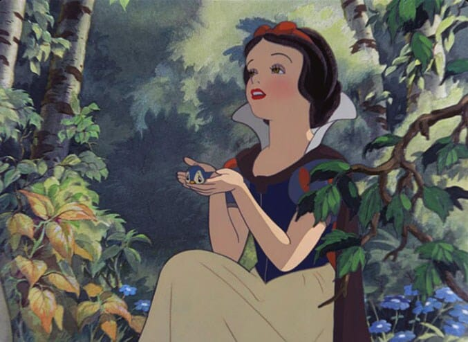 "Snow White holding a blue bird in the animated movie ""Snow White and the Seven Dwarfs"""