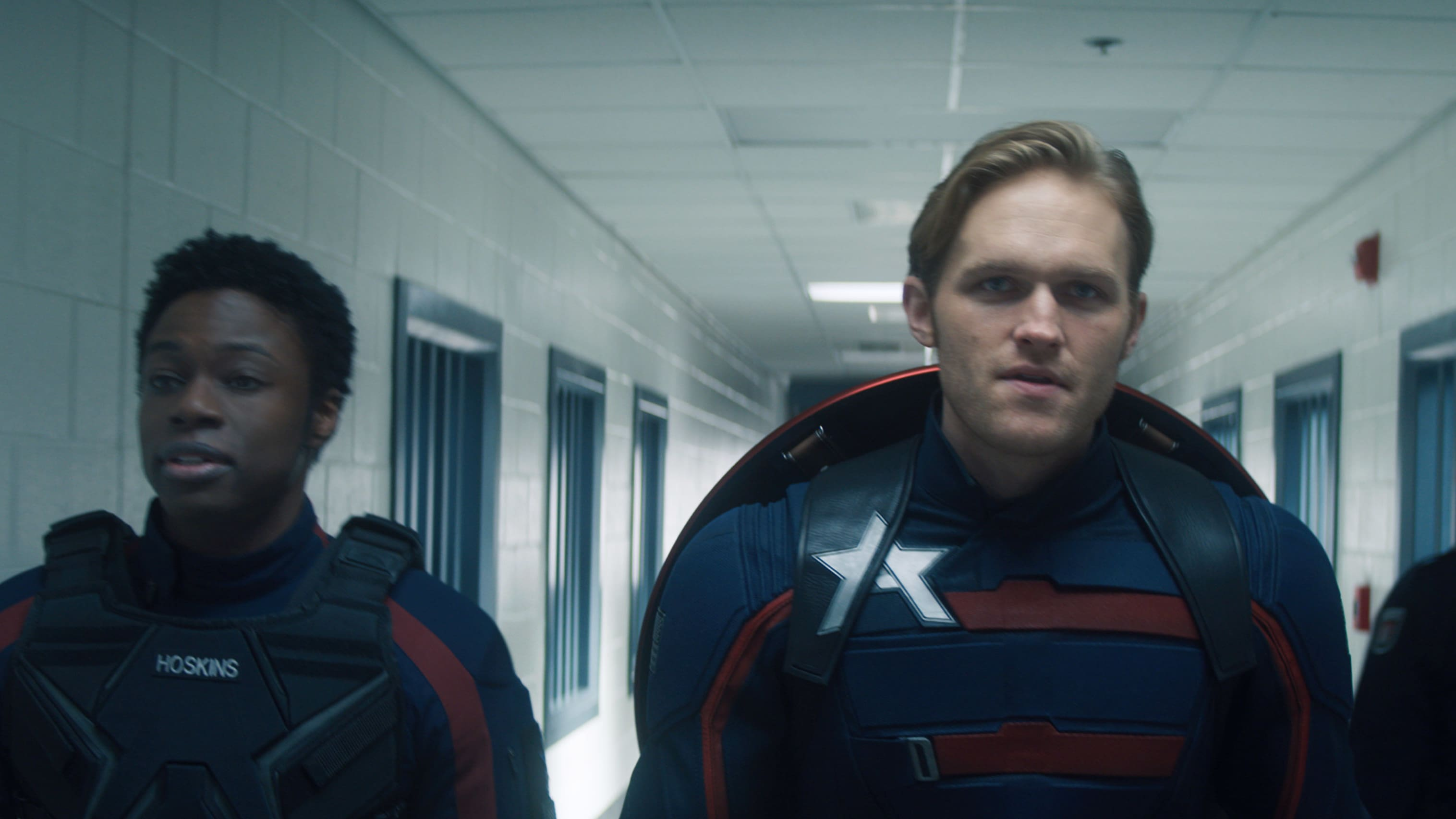 (L-R): Lemar Hoskins (Clé Bennett) and John Walker (Wyatt Russell) in Marvel Studios' THE FALCON AND THE WINTER SOLDIER exclusively on Disney+. Photo courtesy of Marvel Studios. ©Marvel Studios 2021. All Rights Reserved.