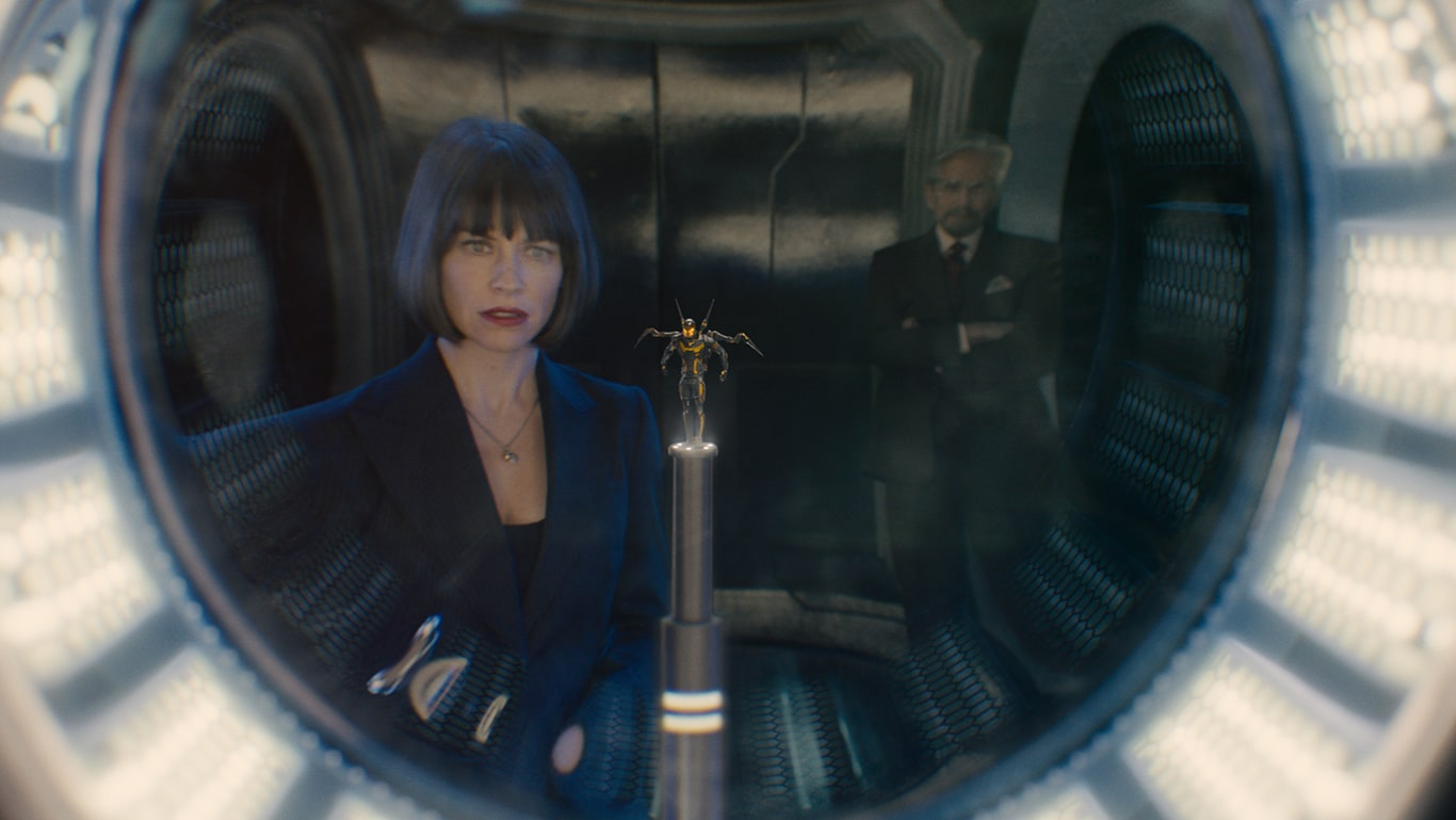 Michael Douglas (as Hank Pym) and Evangeline Lilly (as Hope van Dyne) looking at the wasp suit