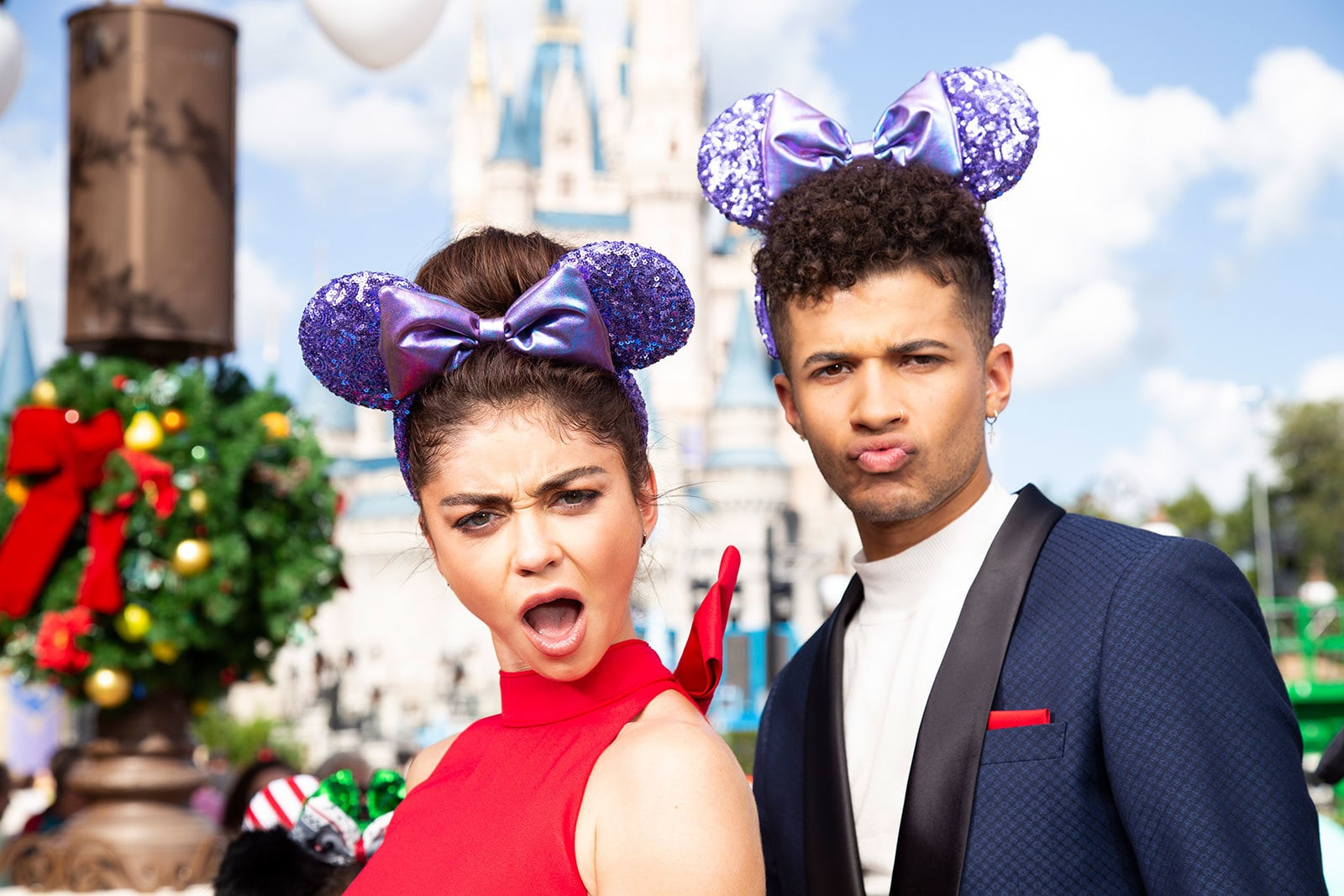 Sarah Hyland and Jordan Fisher wearing the Purple Potion Minnie Ears
