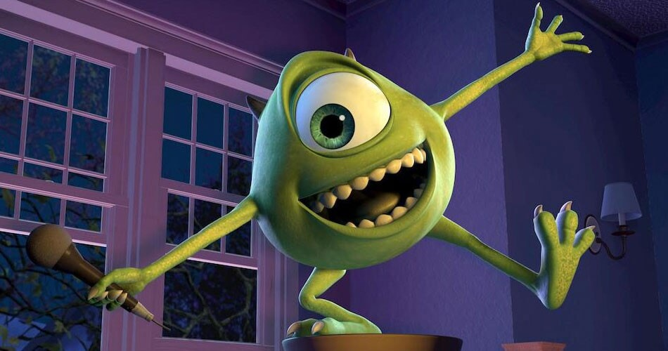 "Mike Wazowski doing standup on a chair in the animated movie ""Monsters, Inc."""