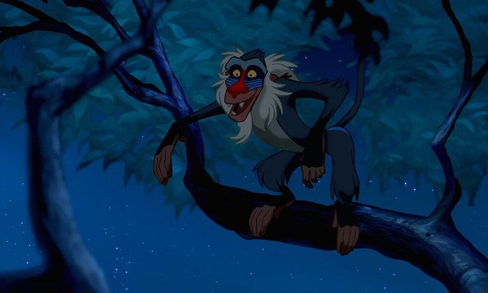 """Animated characters Rafiki (baboon) in a tree from the movie """"The Lion King"""""""