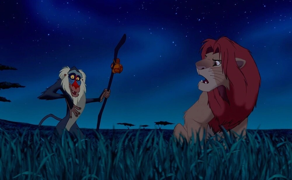 """Animated characters Rafiki (baboon) and Simba (lion) from the movie """"The Lion King"""""""