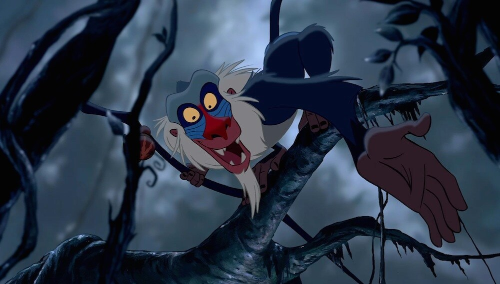 """Rafiki, the baboon, in a tree in the movie """"The Lion King"""""""