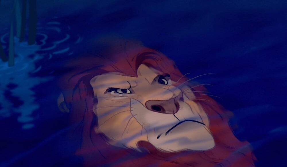 """Mufasa's reflection as seen in the animated movie """"The Lion King"""""""