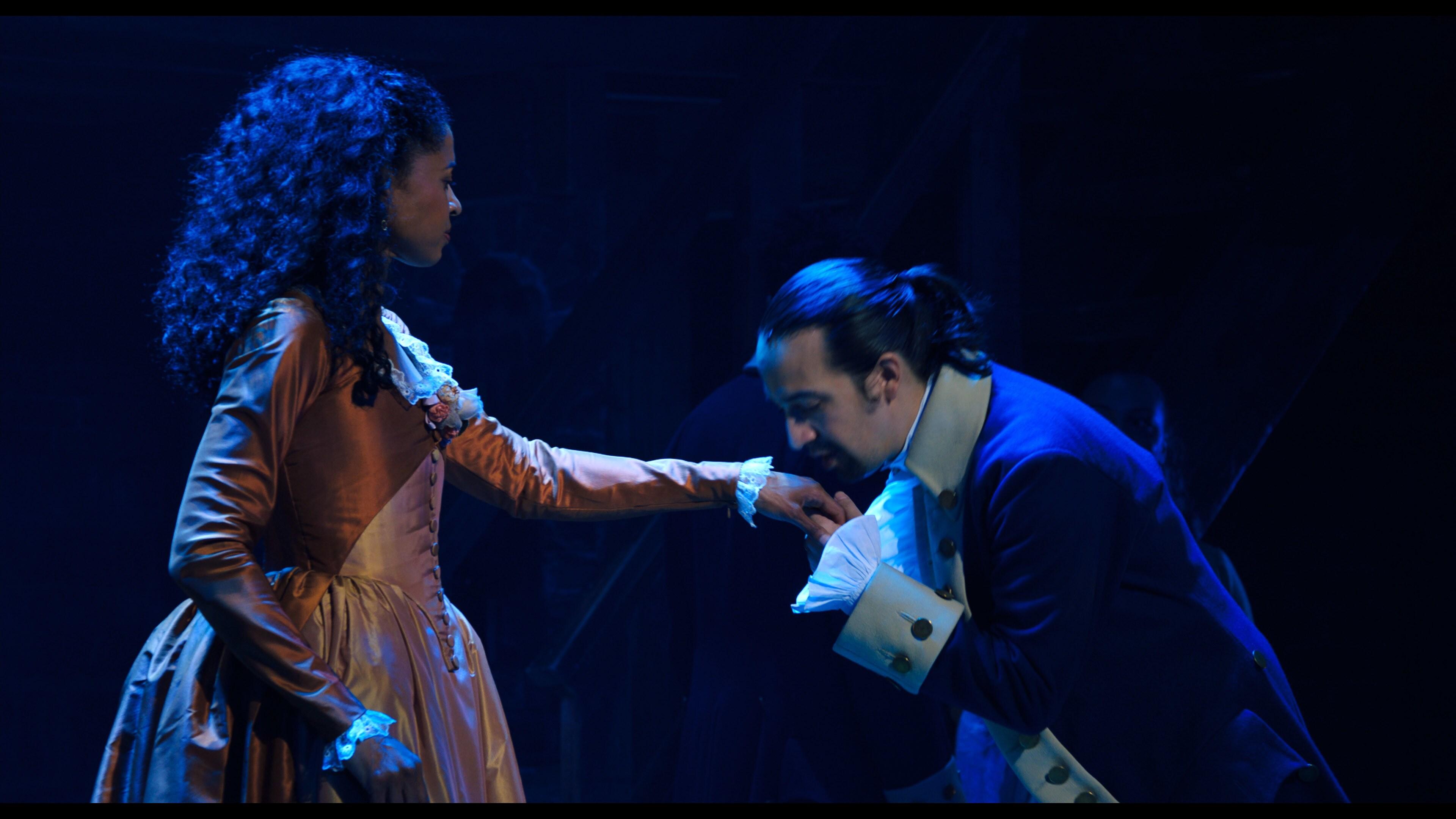 Renée Elise Goldsberry is Angelica Schuyler and Lin-Manuel Miranda is Alexander Hamilton in HAMILTON, the filmed version of the original Broadway production.