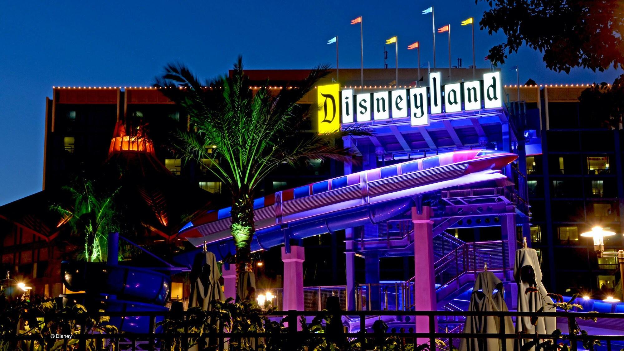Image of the exterior Disneyland hotel at night.