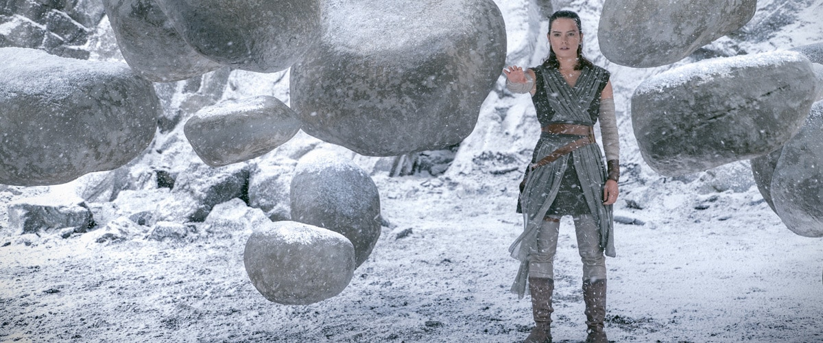 Rey using the Force to lift many heavy boulders