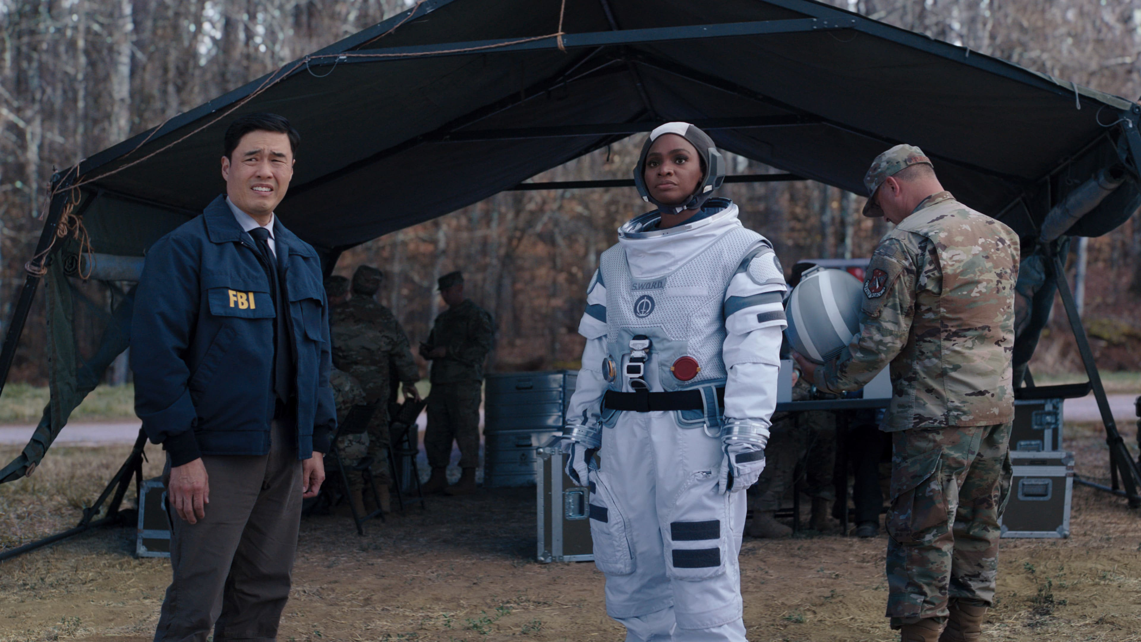(L-R): Randall Park as Jimmy Woo and Teyonah Parris as Monica Rambeau in Marvel Studios' WANDAVISION exclusively on Disney+. Photo courtesy of Marvel Studios. ©Marvel Studios 2021. All Rights Reserved.
