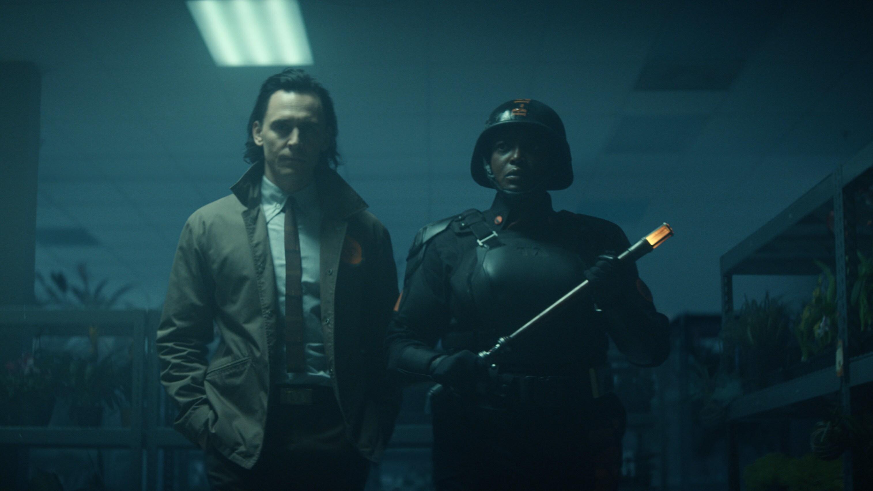 (L-R): Loki (TomHiddleston) and Hunter B-15 (Wunmi Mosaku) in Marvel Studios' LOKI, exclusively on Disney+. Photo courtesy of Marvel Studios. ©Marvel Studios 2021. All Rights Reserved.