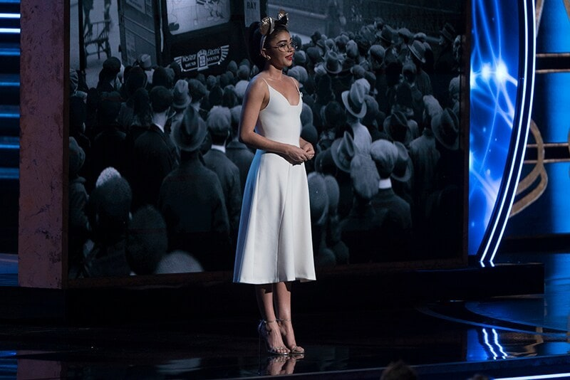 Sarah Hyland presenting in white dress