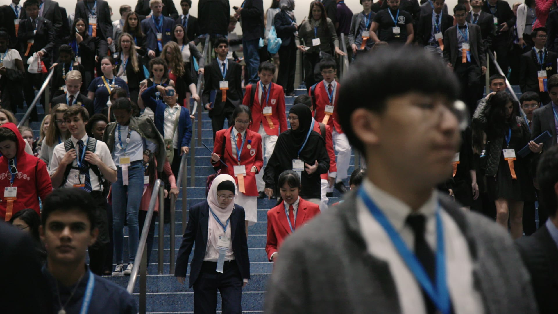 ISEF students walking down stairs after judging.  (National Geographic)