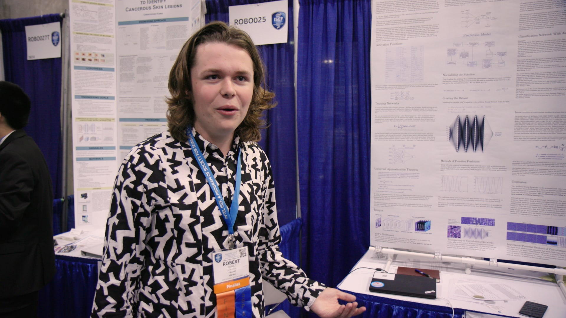 Robbie in front of ISEF board. (National Geographic)