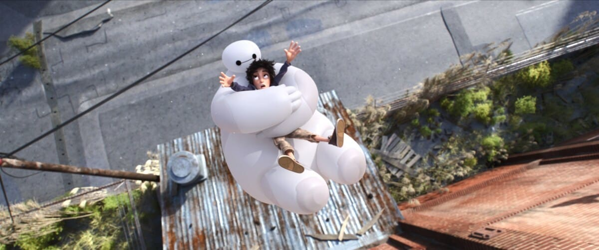 """Baymax protects Hiro as they fall off a building in the animated movie """"Big Hero 6"""""""