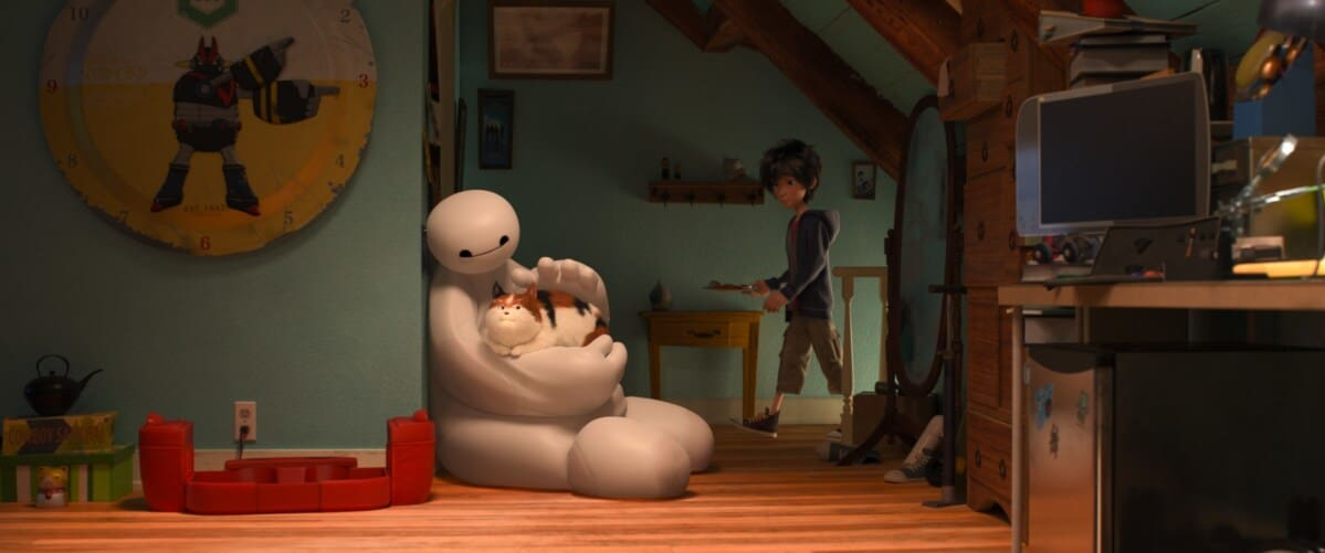 """Baymax sitting on the floor comforting a cat in the animated movie """"Big Hero 6"""""""