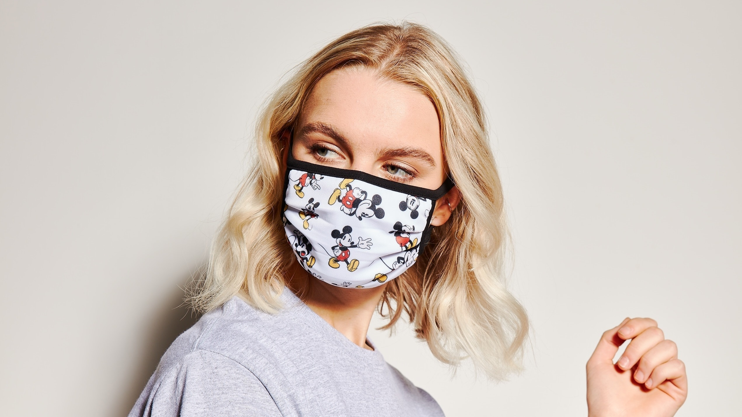 Woman wearing Mickey Face Covering