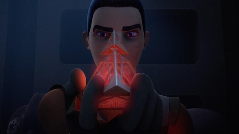 Ezra Bridger holding a Sith holocron