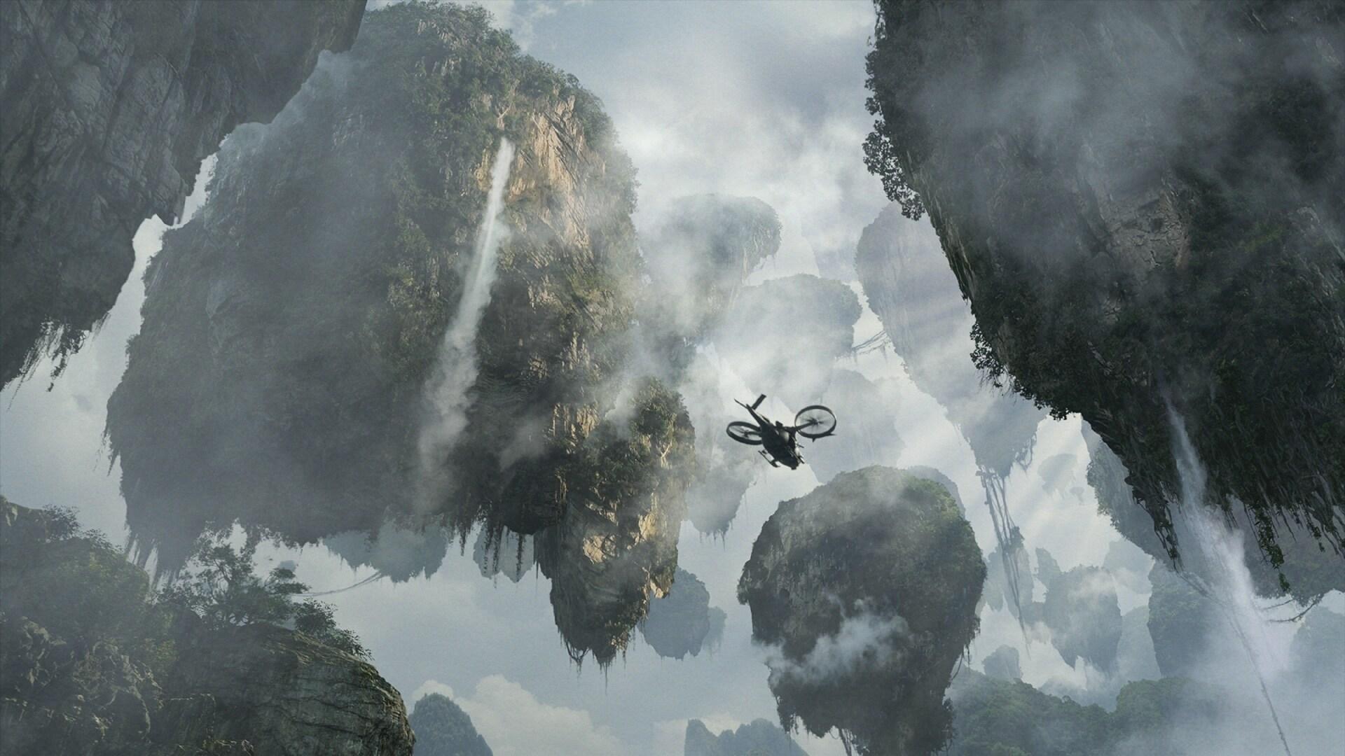 Seen from below, a Samson aircraft flies between the Hallelujah Mountains.