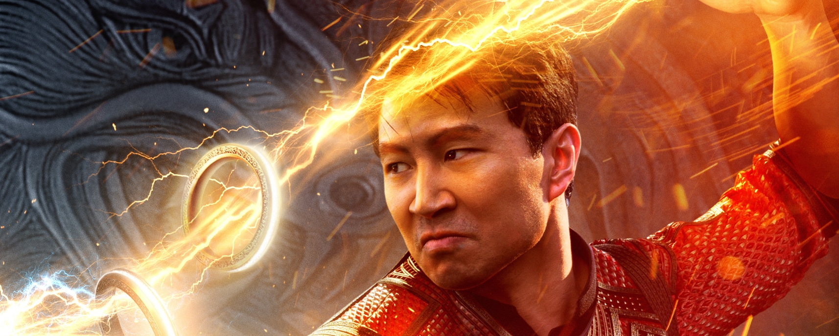 Shang-Chi (Simu Liu) wields the Ten Rings in the theatrical poster for Marvel Studios' Shang-Chi and the Legend of the Ten Rings