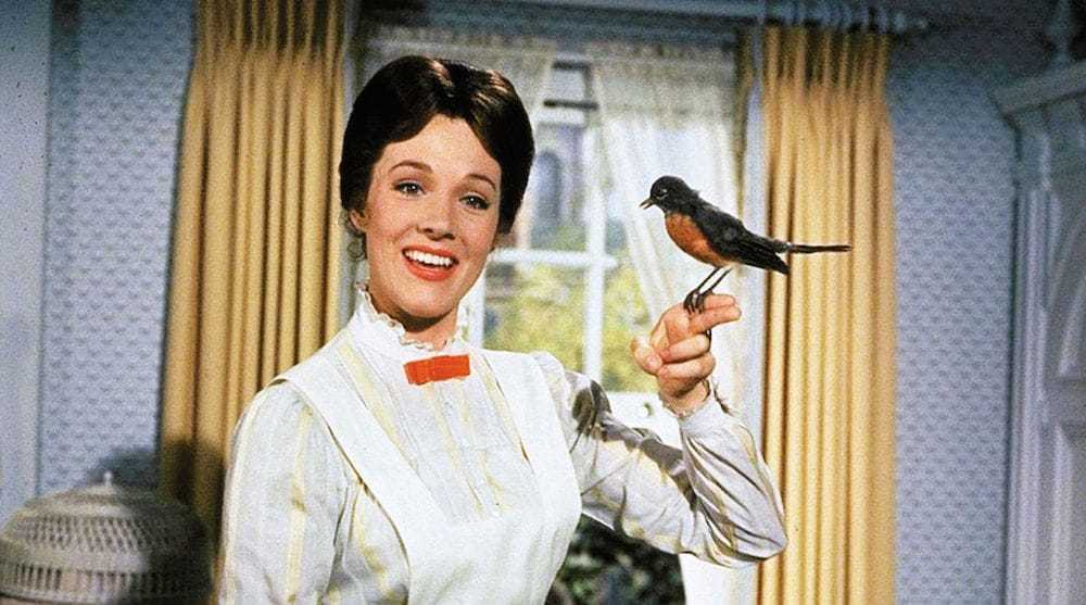 Mary Poppins with a bird sitting on her finger.