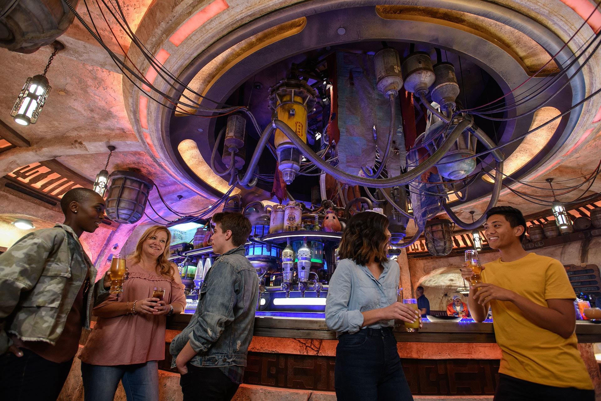 "Oga's Cantina – a local watering hole to unwind, conduct business and maybe even encounter a friend or a foe. Patrons of the cantina come from across the galaxy to sample the famous concoctions created with exotic ingredients using ""otherworldly"" methods, served in unique vessels, with choices for guests of all ages."