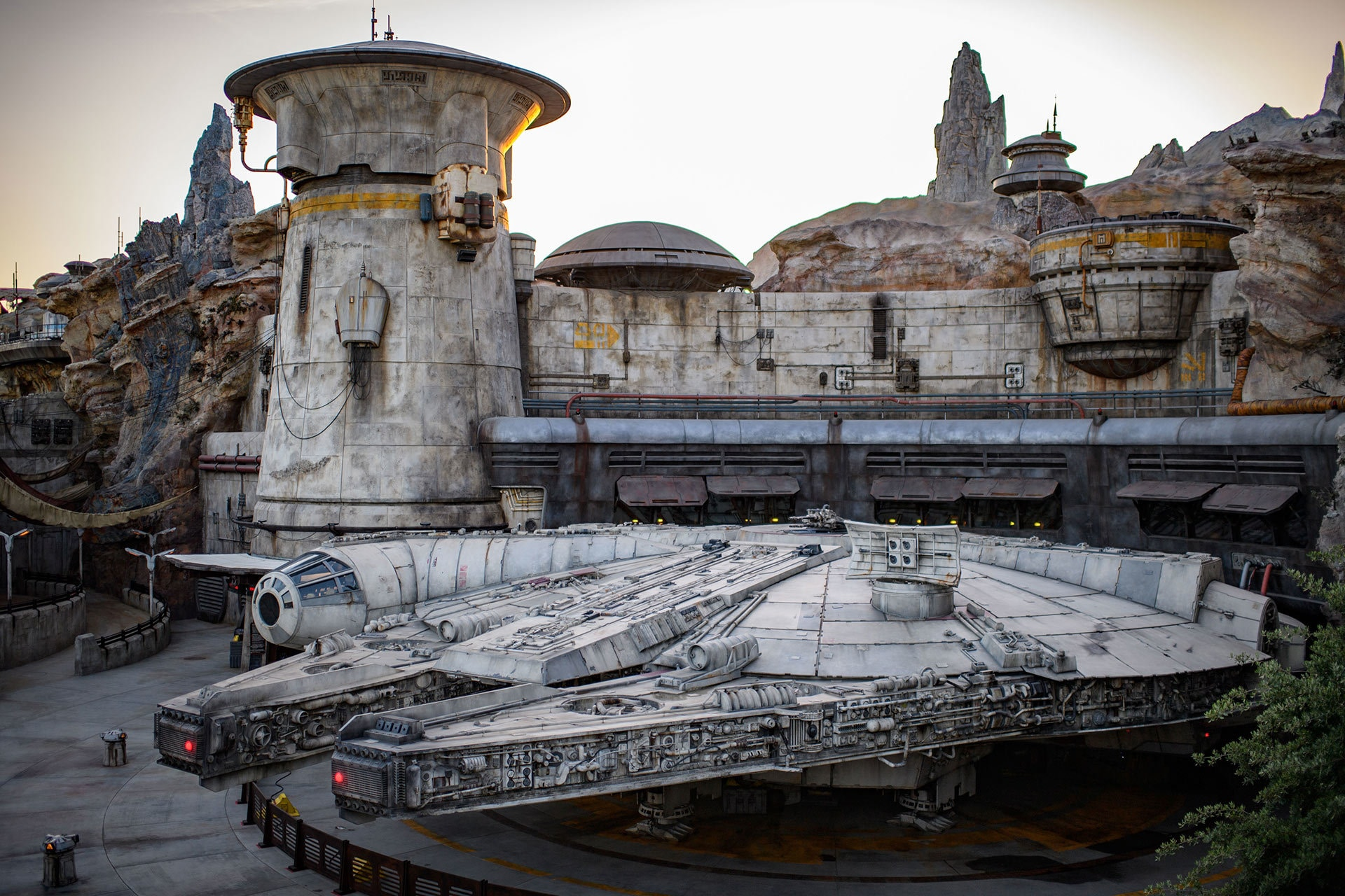 The Millennium Falcon docked in the Black Spire Outpost Spaceport measures more than 100 feet long.