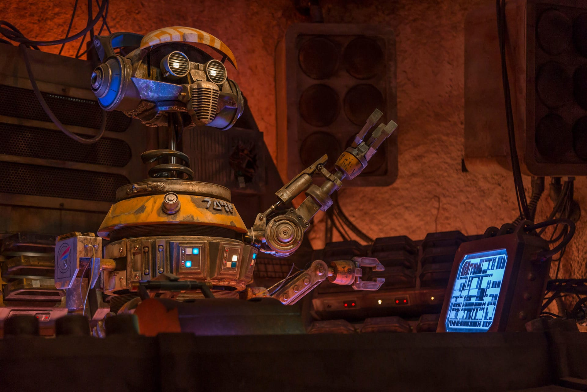 At Black Spire Outpost, the droid in charge of music at the local watering hole, Oga's Cantina, is DJ R-3X, the former Starspeeder 3000 pilot from Star Tours.