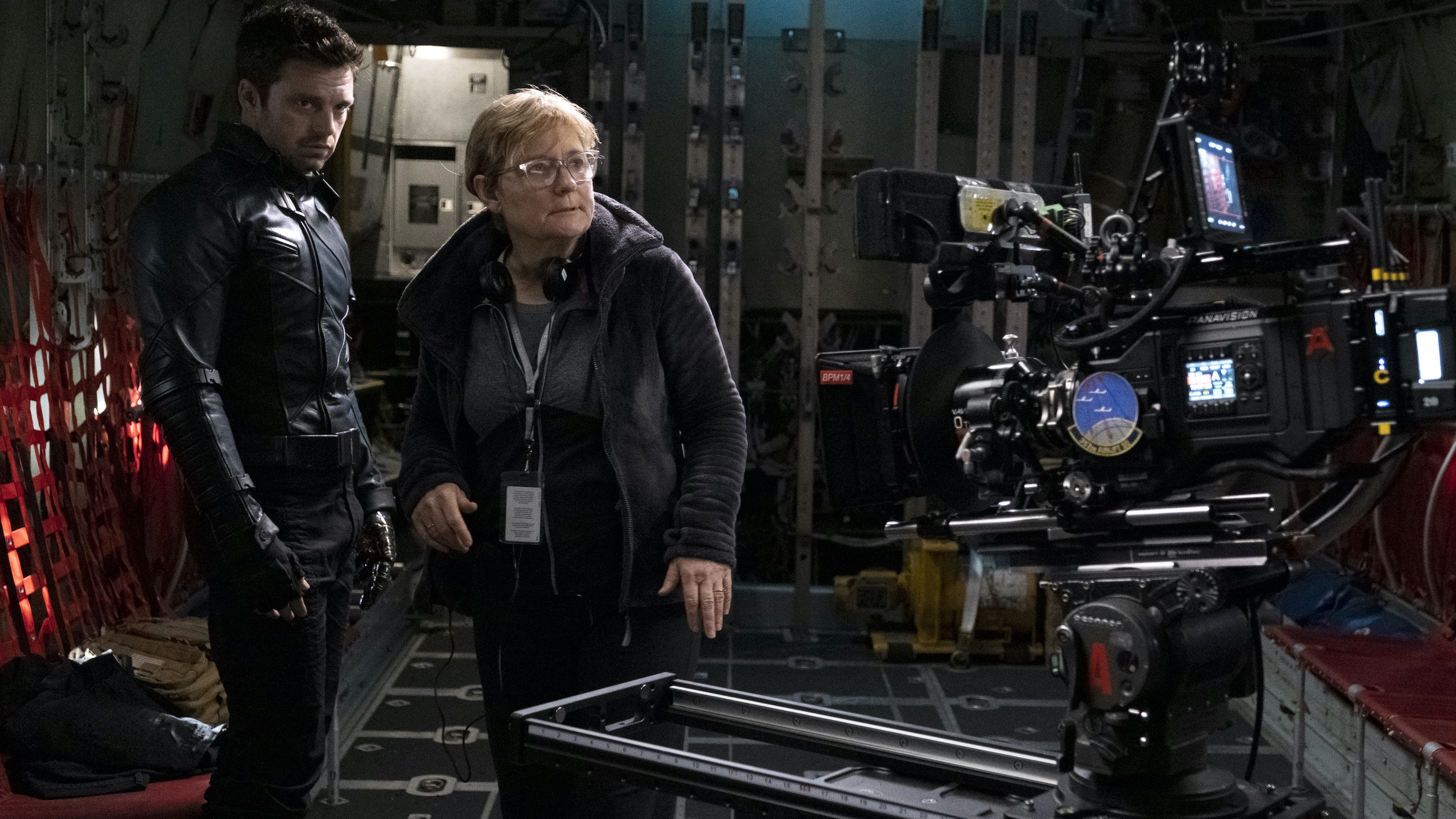 (L-R): Winter Soldier/Bucky Barnes (Sebastian Stan) and Director Kari Skogland on the set of Marvel Studios' THE FALCON AND THE WINTER SOLDIER exclusively on Disney+. Photo by Chuck Zlotnick. ©Marvel Studios 2020. All Rights Reserved.