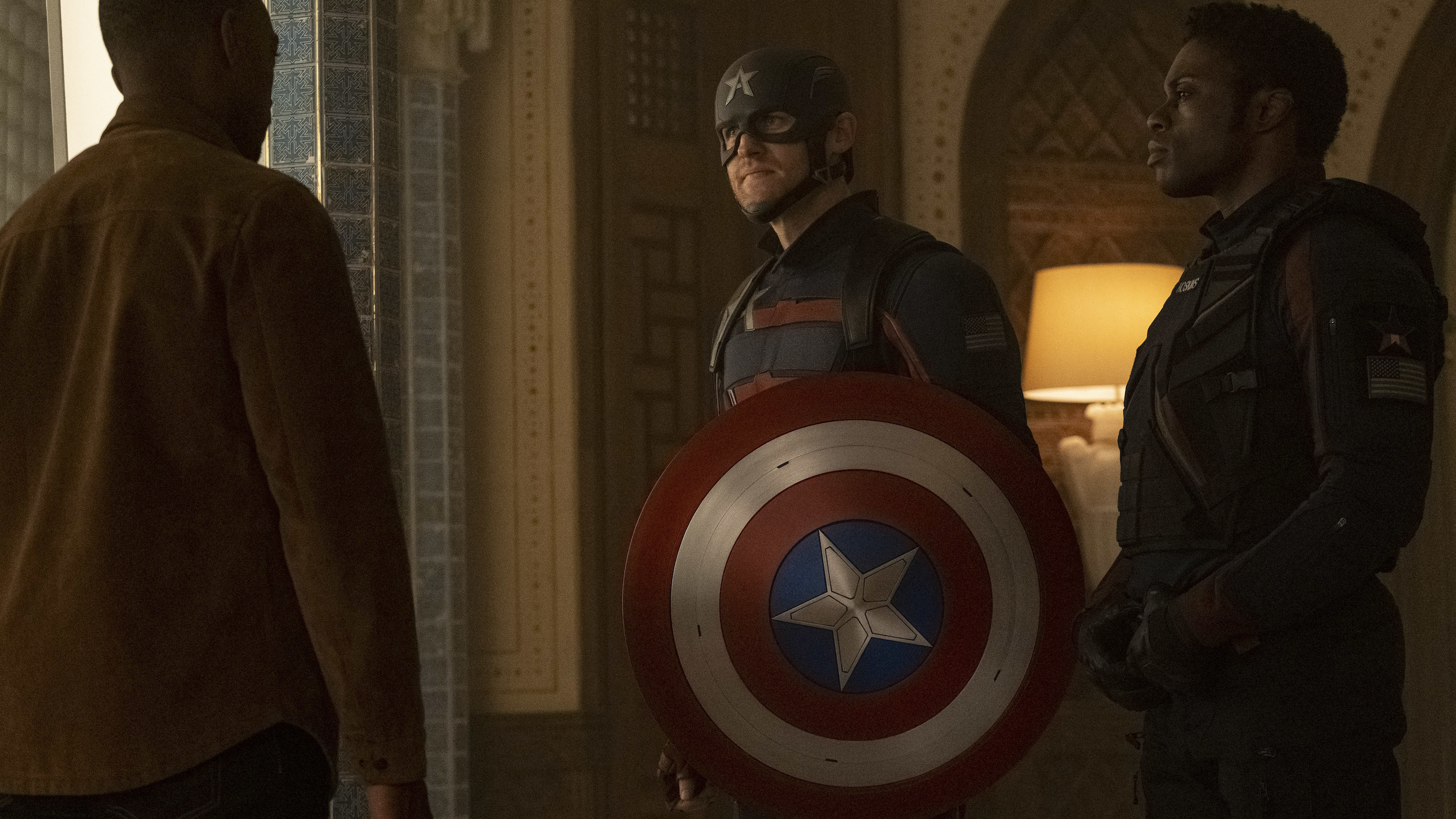 (L-R): Falcon/Sam Wilson (Anthony Mackie), John Walker (Wyatt Russell) and Lemar Hoskins (Clé Bennett) in Marvel Studios' THE FALCON AND THE WINTER SOLDIER exclusively on Disney+. Photo by Chuck Zlotnick. ©Marvel Studios 2021. All Rights Reserved.