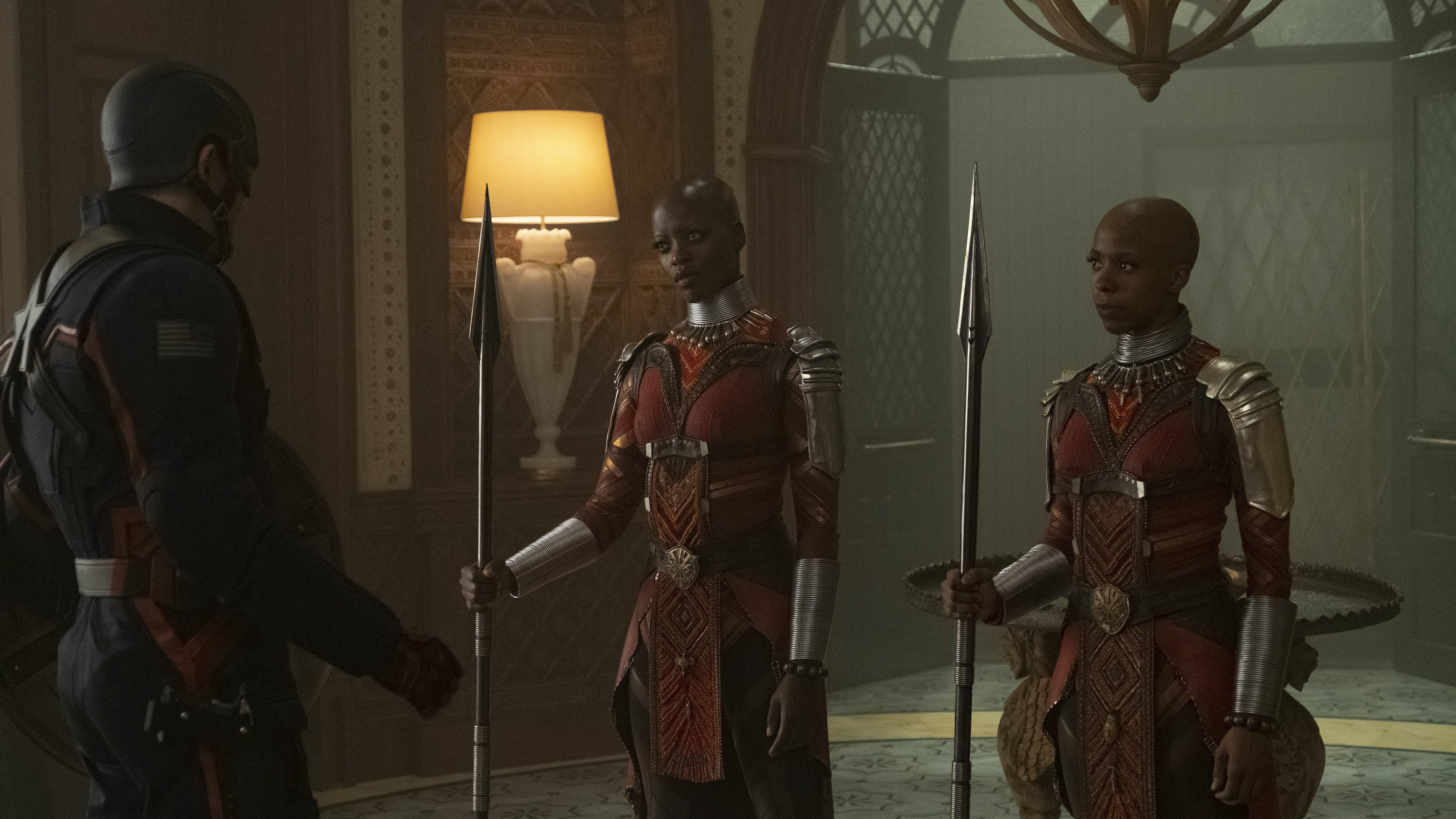 (L-R): John Walker (Wyatt Russell), Ayo (Florence Kasumba) and Yama (Zola Williams) in Marvel Studios' THE FALCON AND THE WINTER SOLDIER exclusively on Disney+. Photo by Chuck Zlotnick. ©Marvel Studios 2021. All Rights Reserved.