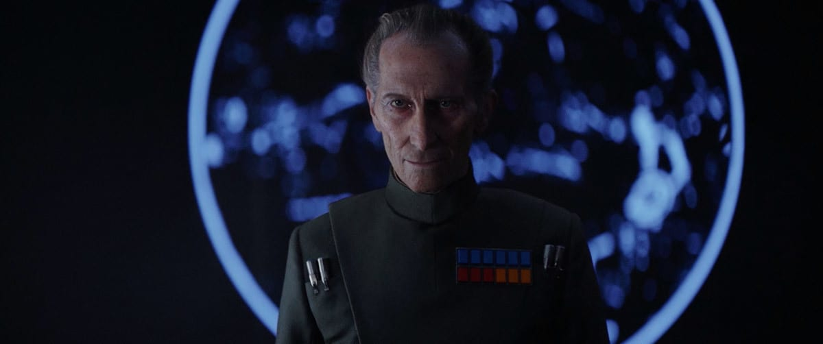 Grand Moff Tarkin standing in front of a holoprojection aboard the Death Star