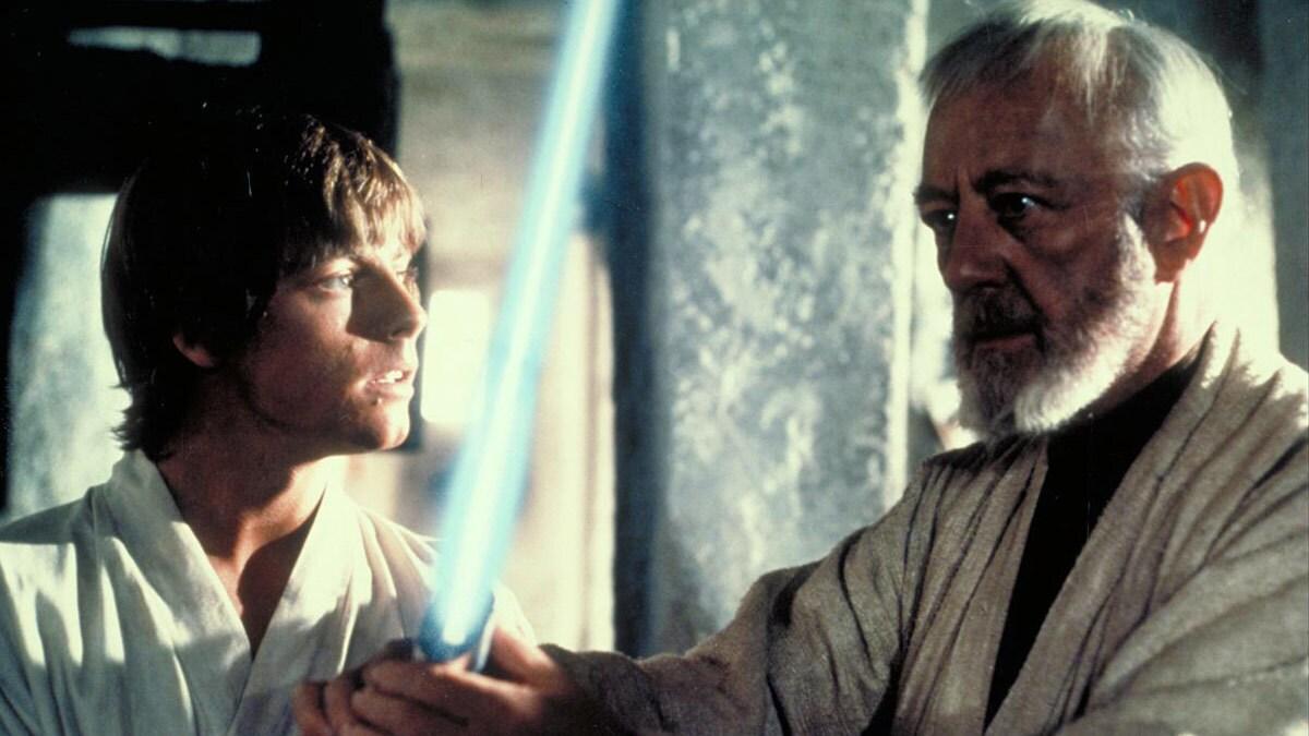Obi-Wan gives lightsaber to Luke