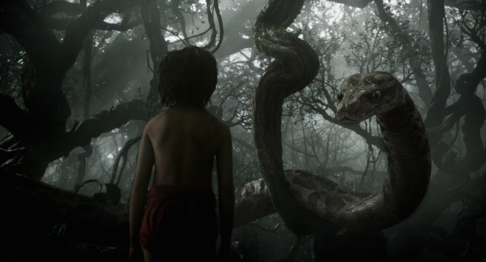 """Mowgli (Neel Sethi) meets Kaa (Scarlett Johansson) in """"The Jungle Book"""""""