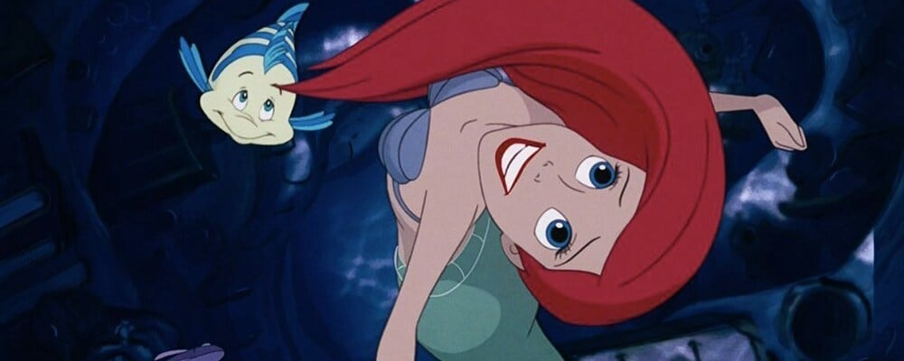 The Little Mermaid's Ariel and Flounder swimming