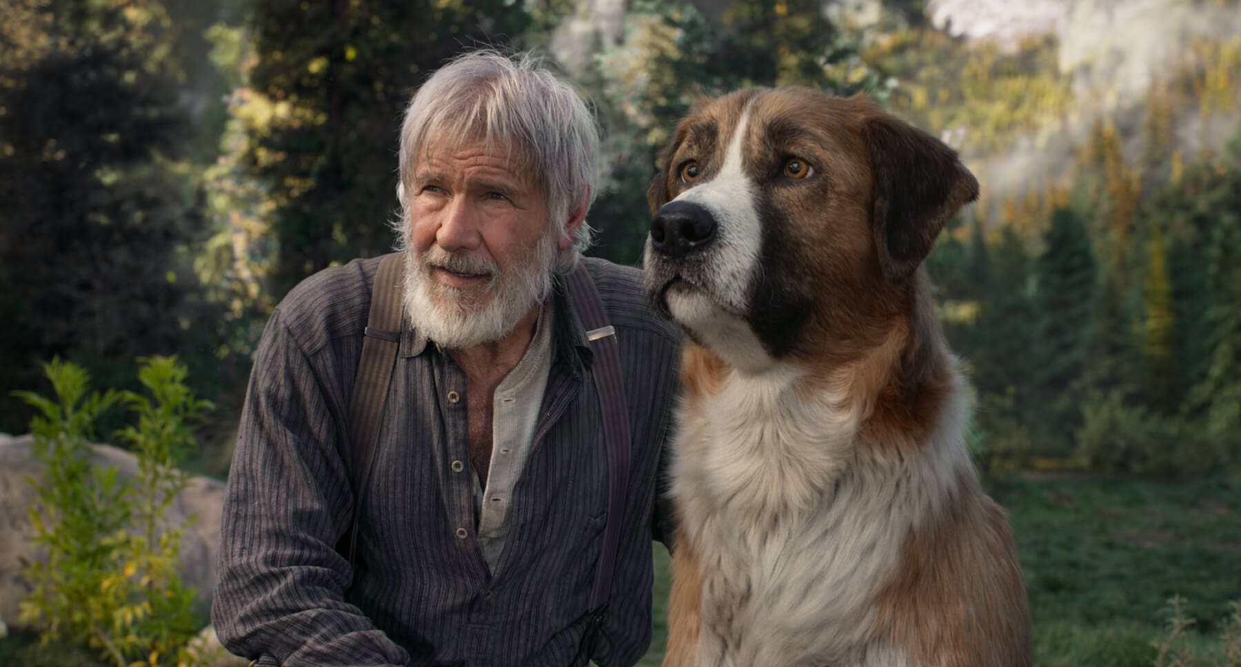 "Actor Harrison Ford (as John Thornton) and dog Buck from the movie ""The Call of the Wild"""
