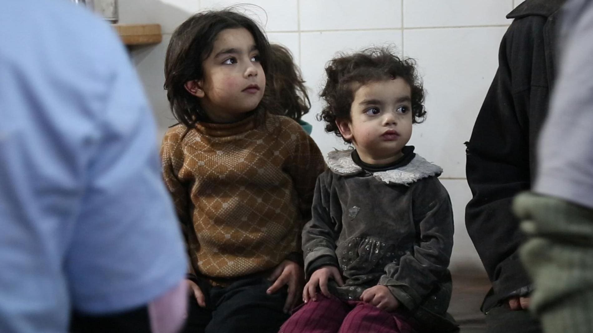 Al Ghouta, Syria - Children waiting for treatment in the underground hospital. (Photo by National Geographic)