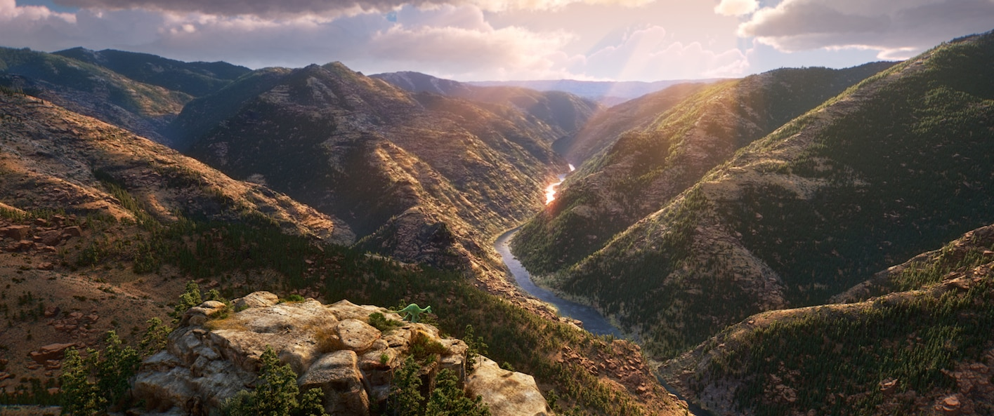 """Raymond Ochoa (Aldo) standing at the top of a mountain overlooking a valley in """"The Good Dinosaur"""""""