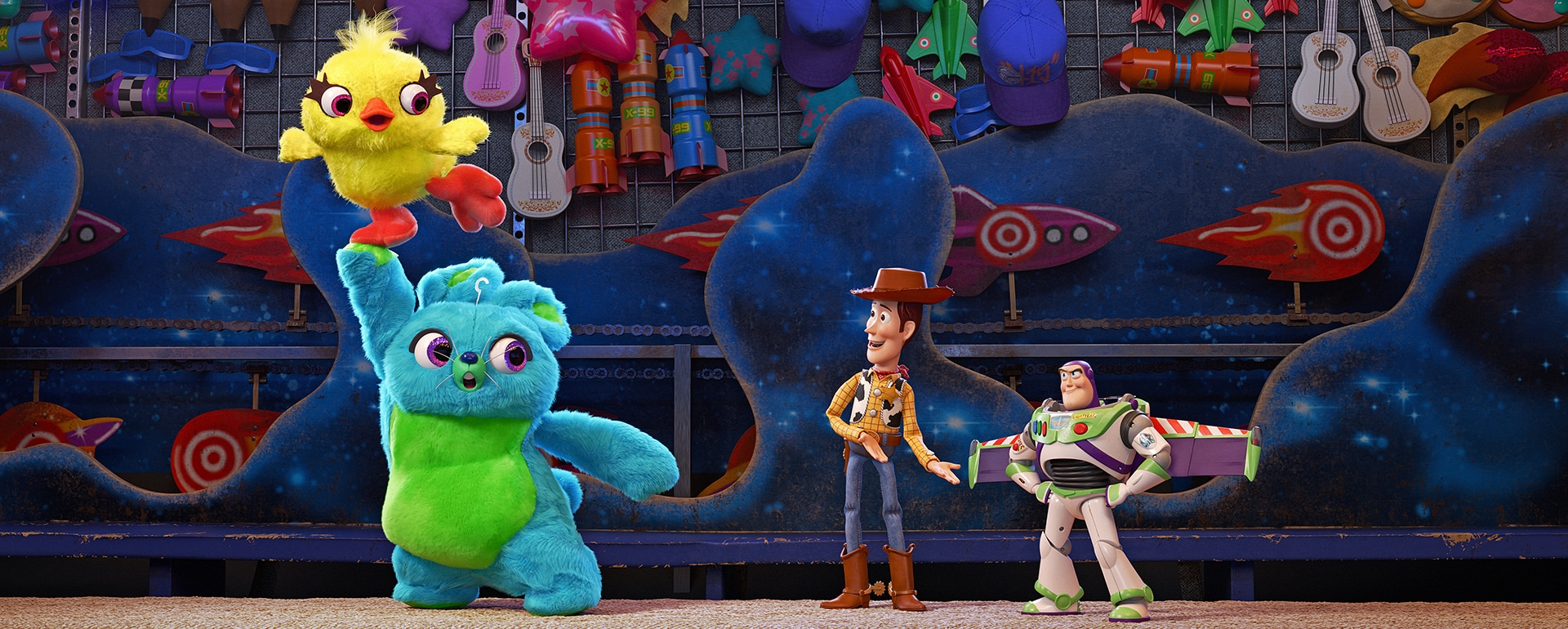 scene from toy story 4 with woody, buzz, ducky, and bunny