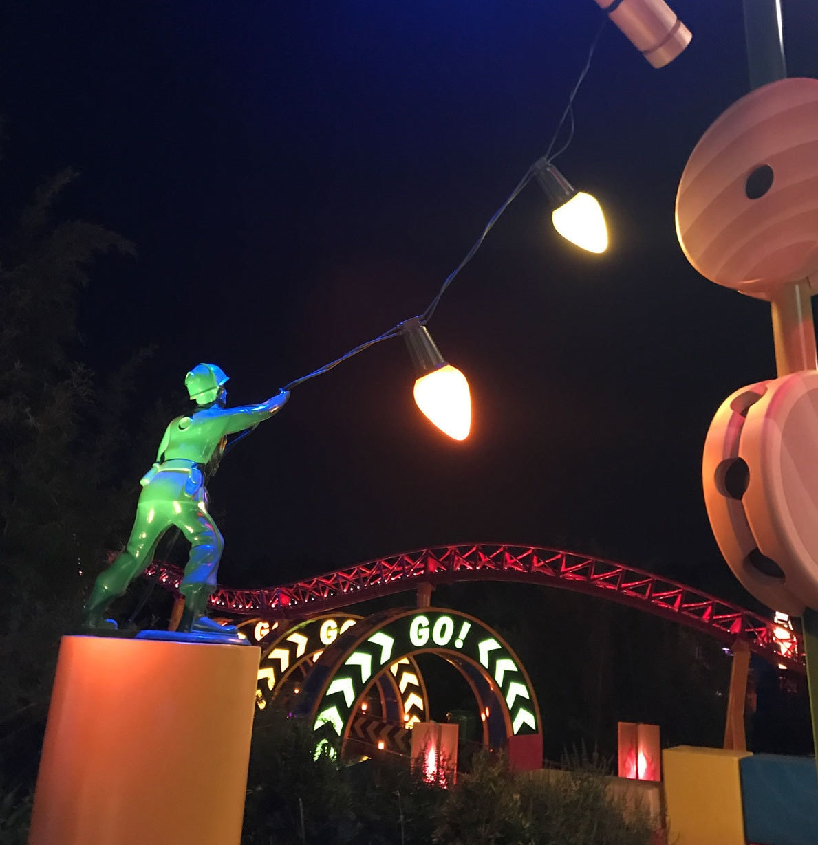 Toy Story Land at Night with Slinky Dog Dash, Lights, and Green Army Man at Walt Disney World
