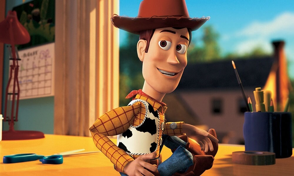 """Animated character Woody sitting in the film """"Toy Story"""""""