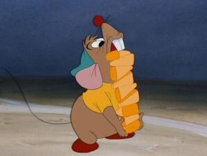 "Gus Gus walking with a stack of corn in the animated movie ""Cinderella"""