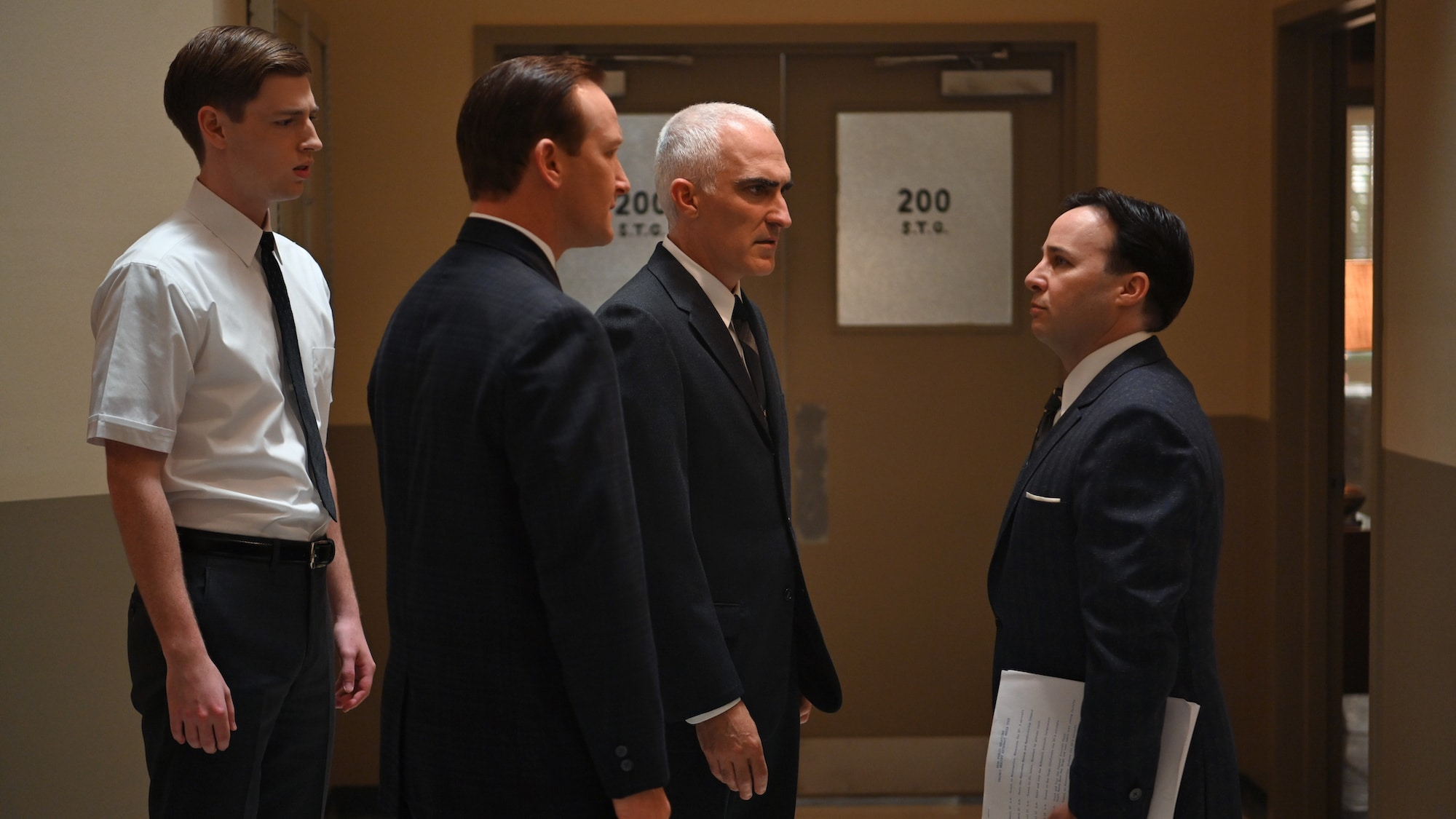 """L to R: Glynn Lunney played by Jackson Pace, Chris Kraft played by Eric Ladin, Bob Gilruth played by Patrick Fischler and John """"Shorty"""" Powers played by Danny Strong in National Geographic's THE RIGHT STUFF streaming on Disney+. (National Geographic/Gene P"""