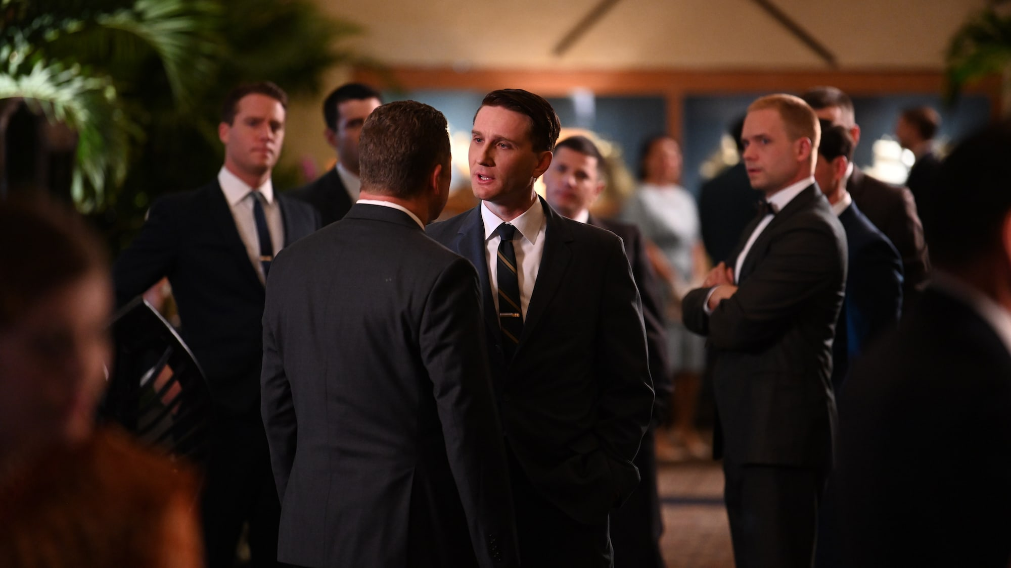 Wally Schirra played by Aaron Staton (center) at a reception in San Diego, CA in National Geographic's THE RIGHT STUFF streaming on Disney+. (National Geographic/Gene Page)