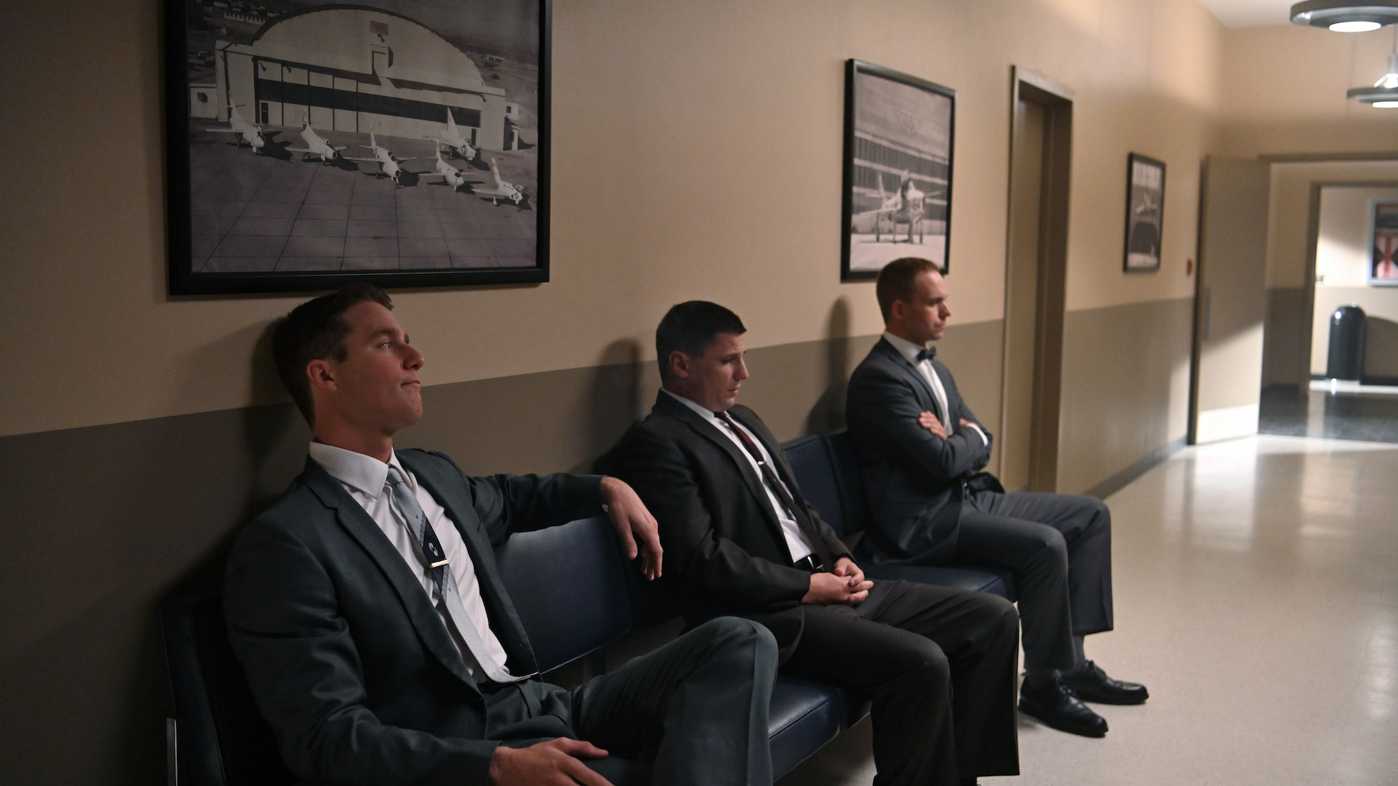 L to R: Jake McDorman as Alan Shepard, Michael Trotter as Gus Grissom and Patrick J. Adams as John Glenn waiting to address the press in National Geographic's THE RIGHT STUFF streaming on Disney+. (National Geographic/Gene Page)