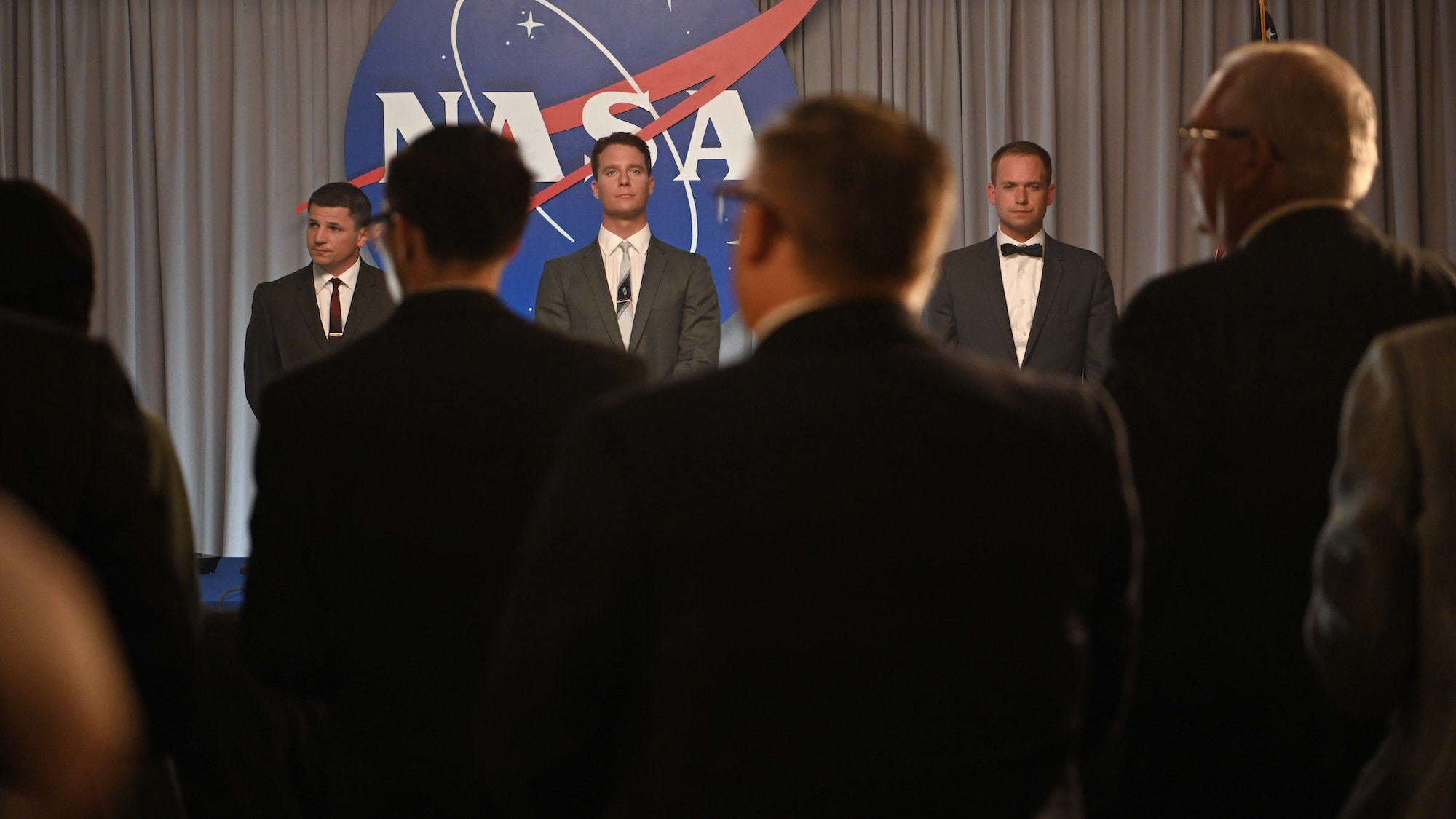 Back L to R: Michael Trotter as Gus Grissom, Jake McDorman as Alan Shepard and Patrick J. Adams as John Glenn during a press conference in National Geographic's THE RIGHT STUFF streaming on Disney+. (National Geographic/Gene Page)