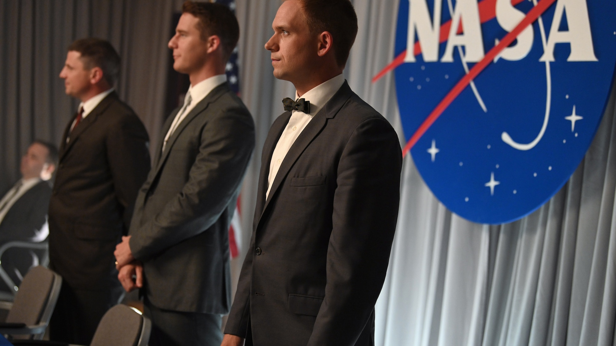 L to R: Michael Trotter as Gus Grissom, Jake McDorman as Alan Shepard and Patrick J. Adams as John Glenn during a press conference in National Geographic's THE RIGHT STUFF streaming on Disney+. (National Geographic/Gene Page)