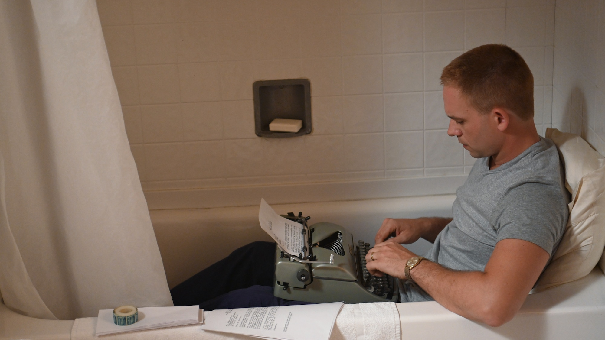 John Glenn, played by Patrick J. Adams, writes a letter in the tub to expose the questionable conduct of a fellow astronaut which could jeopardize the future of the space program in National Geographic's THE RIGHT STUFF streaming on Disney+. (National Geographic/Gene Page)
