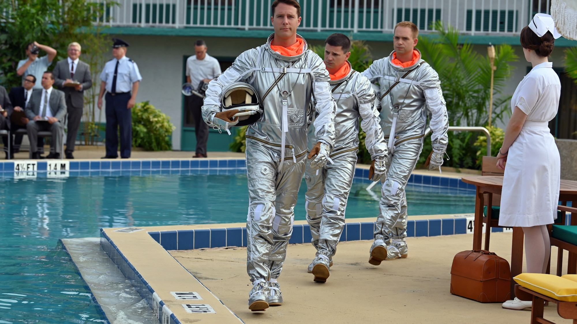 Mercury Seven astronauts (L to R), Alan Shepard played by Jake McDorman, Gus Grissom played by Michael Trotter and John Glenn played by Patrick J. Adams, prior to performing an emergency procedure demonstration in a swimming pool for Dr. Jerome Wiesner and other members of the President's Science Advisory Committee (not pictured) in National Geographic's THE RIGHT STUFF streaming on Disney+. (Credit: National Geographic/Gene Page)