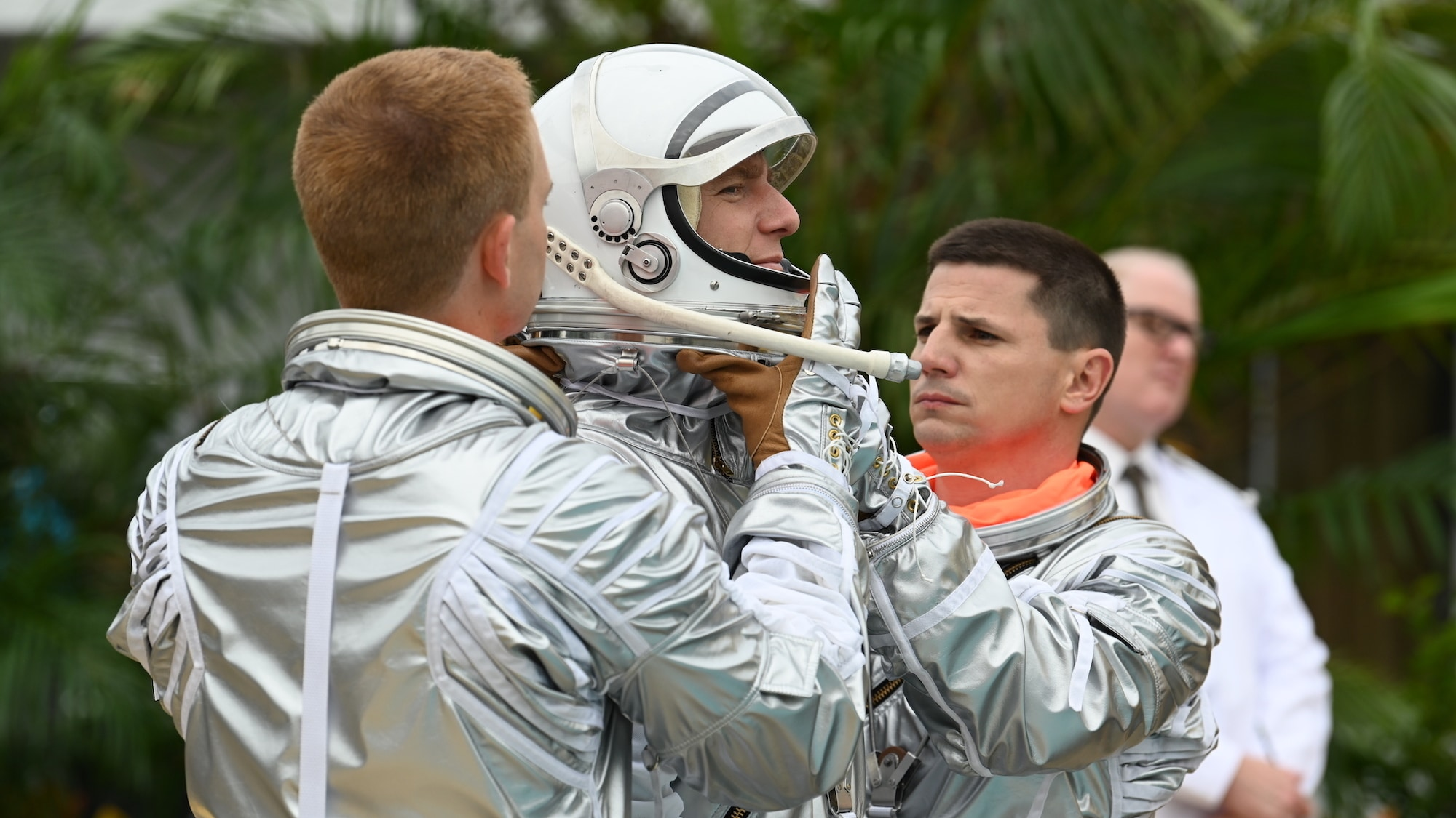 L to R: Patrick J. Adams as John Glenn, Jake McDorman as Alan Shepard and Michael Trotter as Gus Grissom during an emergency procedure demonstration in a swimming pool for Dr. Jerome Wiesner and other members of the President's Science Advisory Committee (not pictured) in National Geographic's THE RIGHT STUFF streaming on Disney+. (Credit: National Geographic/Gene Page)