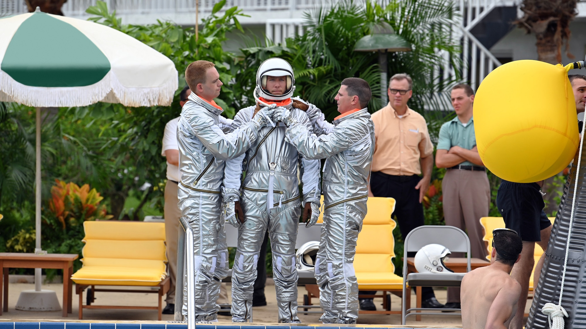 Center L to R: Patrick J. Adams as John Glenn, Jake McDorman as Alan Shepard and Michael Trotter as Gus Grissom during an emergency procedure demonstration in a swimming pool for Dr. Jerome Wiesner and other members of the President's Science Advisory Committee (not pictured) in National Geographic's THE RIGHT STUFF streaming on Disney+. (Credit: National Geographic/Gene Page)